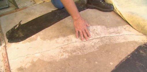 Crack in concrete slab under floor.