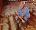 Danny Lipford in attic.
