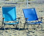 Chairs in sand on beach.