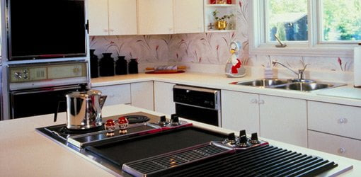 kitchen island stove how to clean silgranit sinks choose a or refrigerator for your today s with cooktop and built in cabinet range