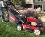 Cutting grass with Toro lawn mower.