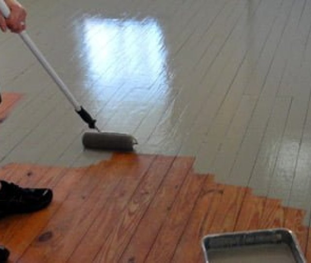 Using A Roller To Paint Our Wood Floor