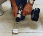 Homemade scrub brush drill attachment chucked into drill.