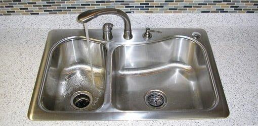 Kitchen sink with garbage disposal.