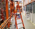 Werner fiberglass podium ladder in Home Depot store.