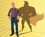 Man with tool belt and superhero shadow.