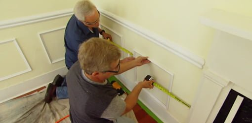 chair rail upside down swivel bunnings interior molding makeover project today s homeowner installing white faux wainscoting on yellow walls in living room