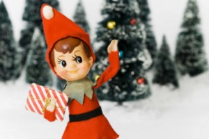 elf on the shelf in front of a wintry background
