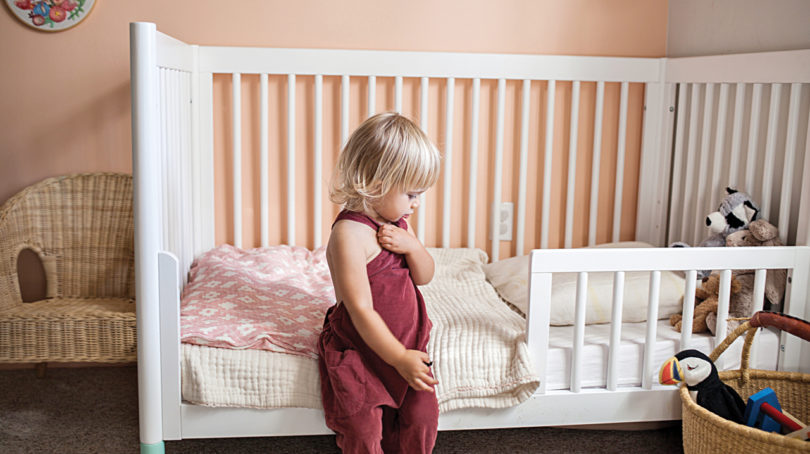 a pillow in your toddler s crib or bed