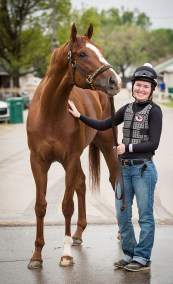 """Exercise rider and aspiring jockey, Kylie Wellingon, is in from Iowa for her first Derby week. """"There are a lot of trainers who believe that girls get a long better with horses, but there are also trainers who think girls shouldn't be out there."""""""