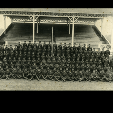 Men of the 12 Canadian Mounted Rifles in front of the grandstand at the Red Deer Exhibition grounds, May 1915.