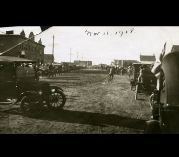 Parade on Ross Street, in front of the Red Deer City Hall, to celebrate the end of the First World War, November 11, 1918