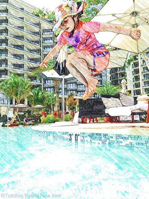 Cayman - Kimpton Seafire Hotel - T jumping into pool
