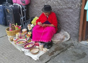 Older woman weaving traditions old baskets