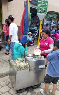 Woman selling quail eggs