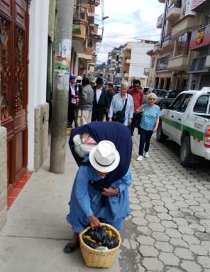 Woman picking up her basket