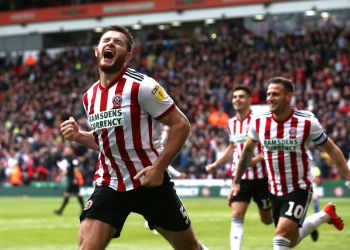 SHEFFIELD, ENGLAND - APRIL 27:  Jack O'Connell of Sheffield United (5) celebrates after scoring his team's second goal during the Skybet Championship match between Sheffield United and Ipswich Town at Bramall Lane on April 27, 2019 in Sheffield, England. (Photo by Jan Kruger/Getty Images)