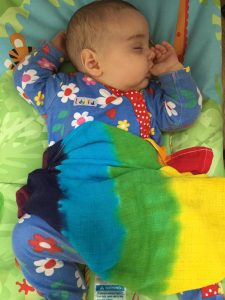 Baby fast asleep with her custom order muslin