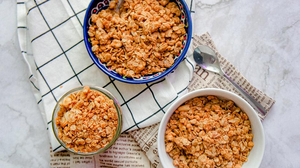 Close up three bowls with homemade vegan granola