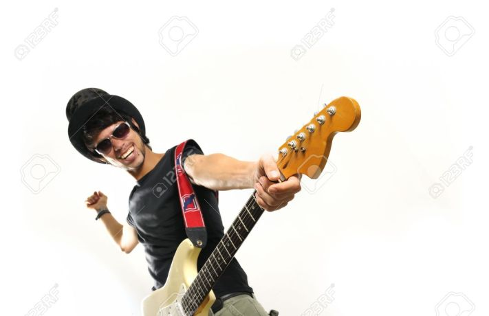 5395907-Portrait-of-young-crazy-guy-playing-electric-guitar-isolated-Stock-Photo