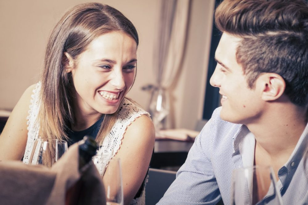 Man-and-woman-in-bar-laughing