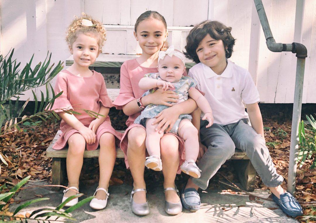 Four children wearing Toke Shoes