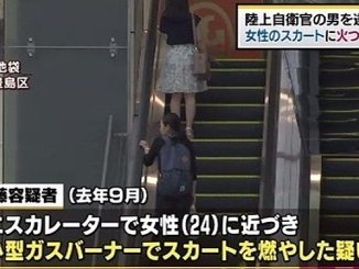 Police accused a GSDF member of lighting a woman's skirt on fire on an escalator in Ikebukuro