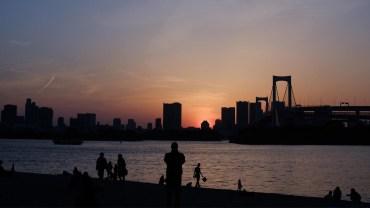 Enjoying the sunset, Tokyo skyline, and a good drink on the beach