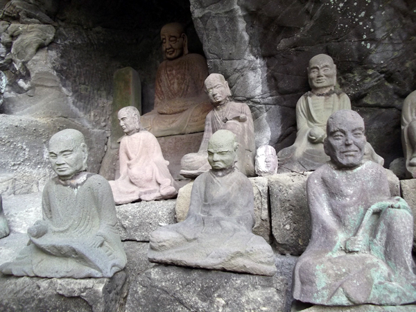 Statues of Buddhist devotees and deities