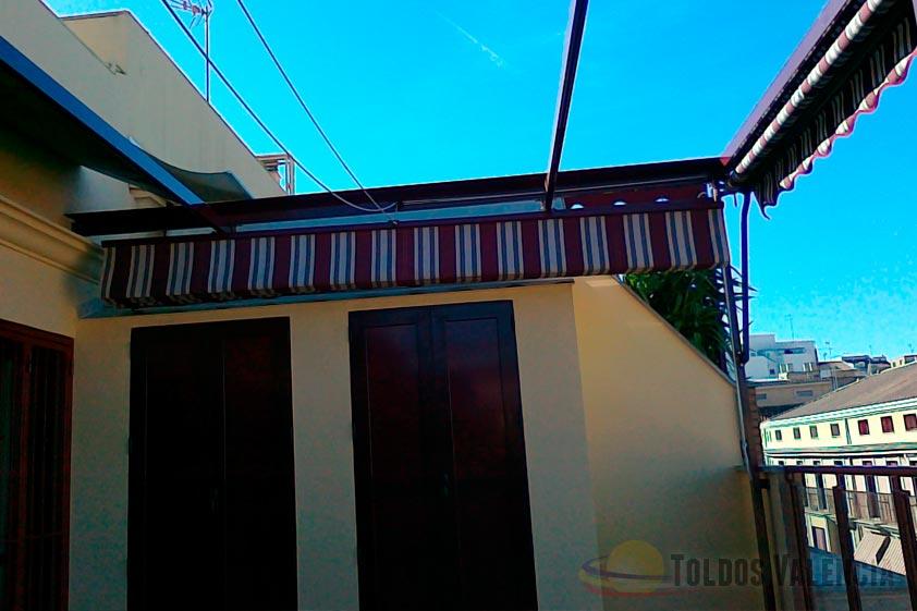 Toldo plano para terrazas toldos valencia for Toldos para comercios