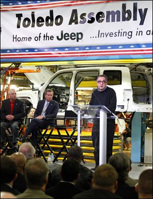 Chrysler's Sergio Marchionne, right, details plans for the Toledo complex. With him Wednesday were Ken Lortz, UAW Region 2B director, left, and Gov. John Kasich.