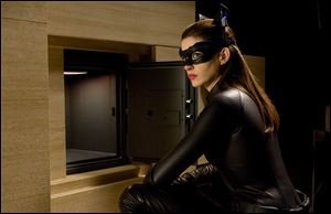 Anne Hathaway portrays Catwoman.