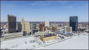 This photo of downtown was taken by a drone for Toledo Aerial Media. Drones can be used for much more than taking pictures of weddings and sporting events, proponents say.