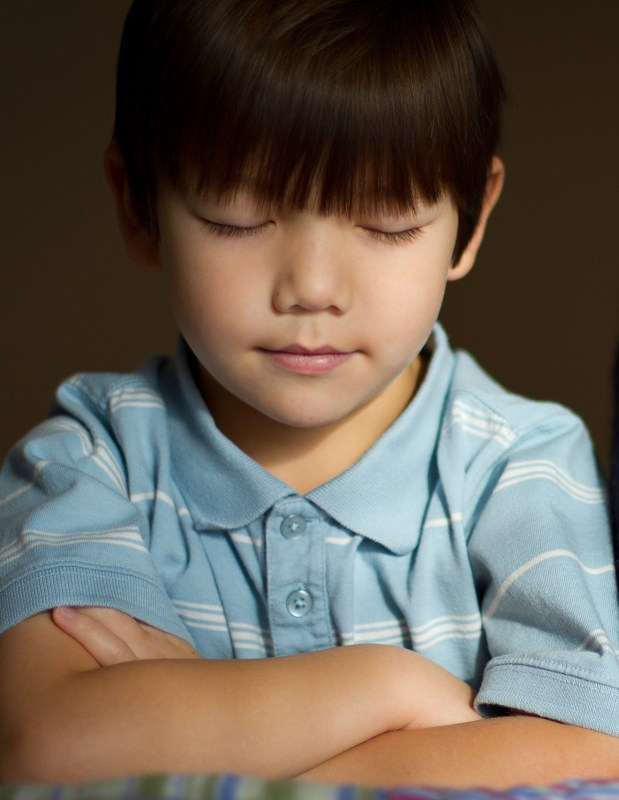 child folding arms in prayer