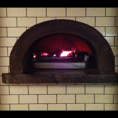 Wood fired cooking is central to the theme.