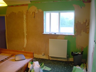 pic of bedroom with walls being stripped