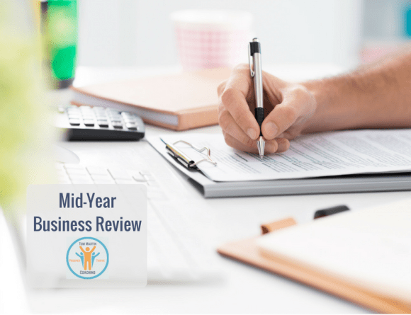 Photo Small Business Owner Mid-Year Business Review