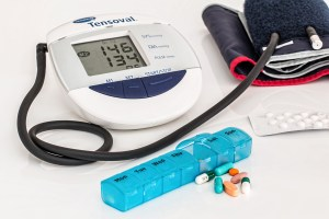 blood pressure monitor, pill holder and pills