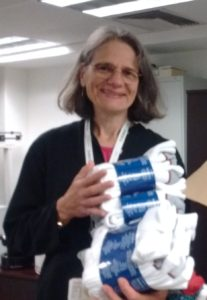 Laura holding some of the donated socks