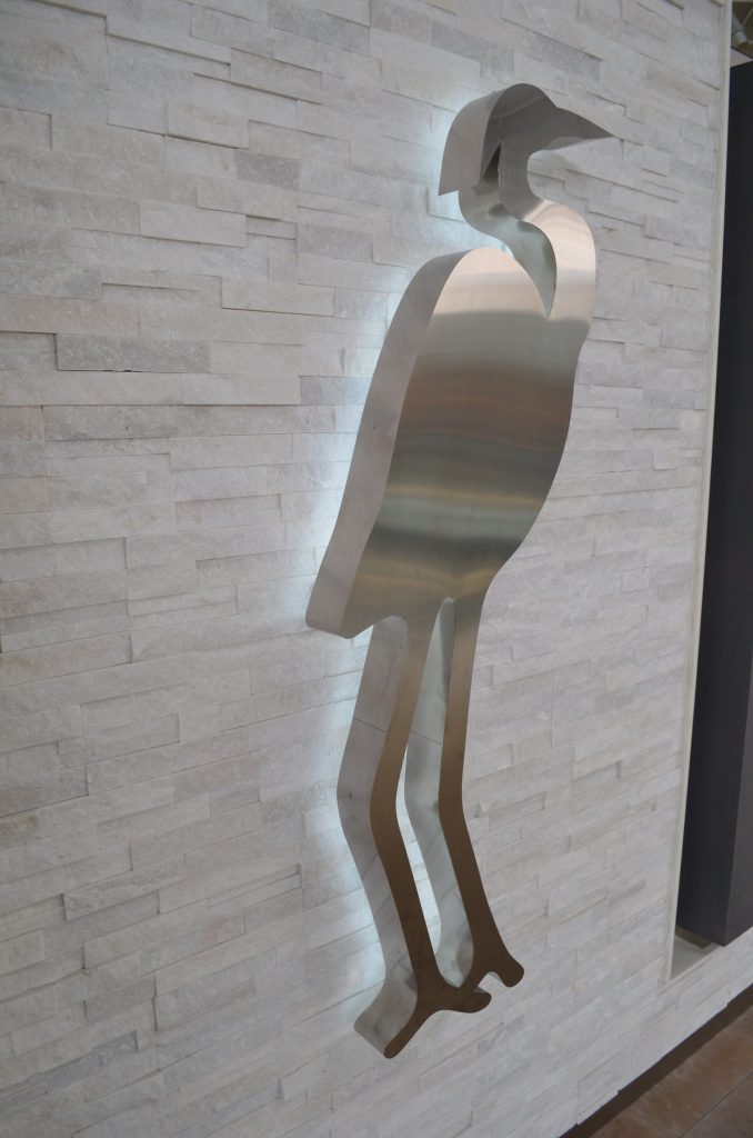 This backlit silver heron is important to the client's brand and so it was moved to the exterior/ storefront.