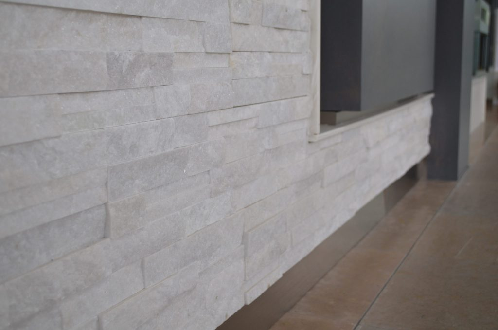 The textured stone has a shimmer to it--adding a beachy, yet contemporary, feel.