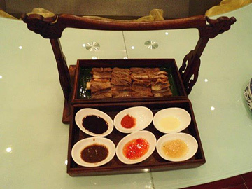 Beef on the bone inside a tiered wooden box