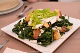 Roasted apples, kale, brioche shards, ricotta salata, browned butter vinaigrette, celery leaves