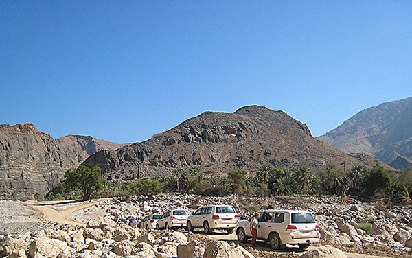 Our 4x4 vehicles for the Ace Study Tour makes a Wadi Stop on a Christmas tour of Oman