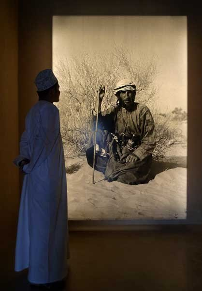 Wilfred Thesiger Photo sitting in his Arabian Sands on out trip Abu Dhabi and Wilfred Thesiger