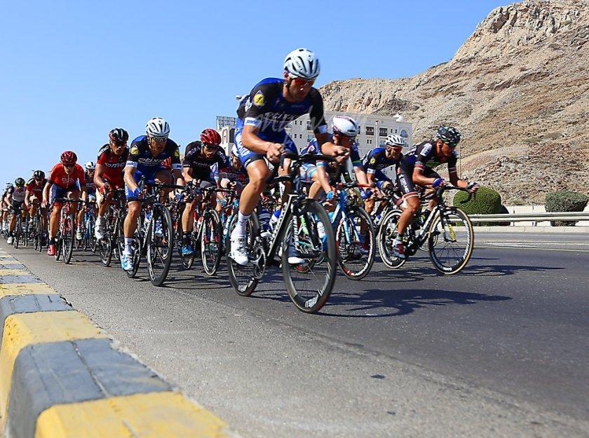 Tour of Oman Peloton flashes through Hamriyah