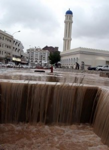 Rain floods the streets in Muscat