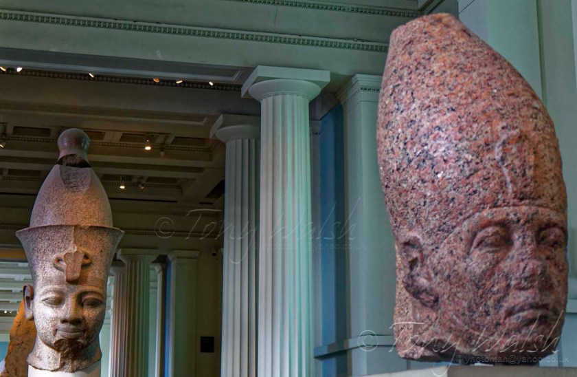 red granite heads of Amenhotep III and Senusret III