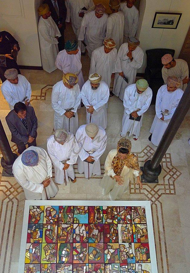 Dr Mona Al Baiti explains a painting to Sheikh Hamed Bin Hilal Bin Ali Al Mamary on the far left