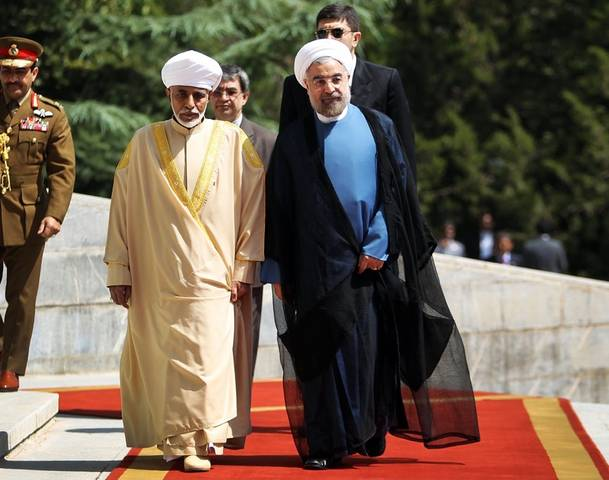 Sultan Qaboos (L) and Hassan Rouhani in Tehran August 2013